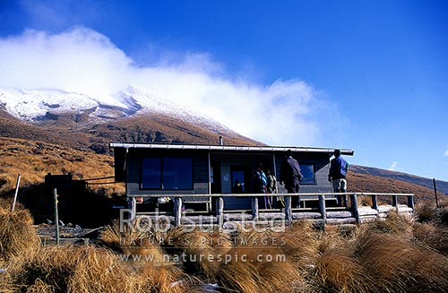 Ketetahi Hut on the Tongariro Northern Circuit track. Mount (Mt) Tongariro above, Tongariro National Park, Taupo District, Waikato Region, New Zealand (NZ) stock photo.