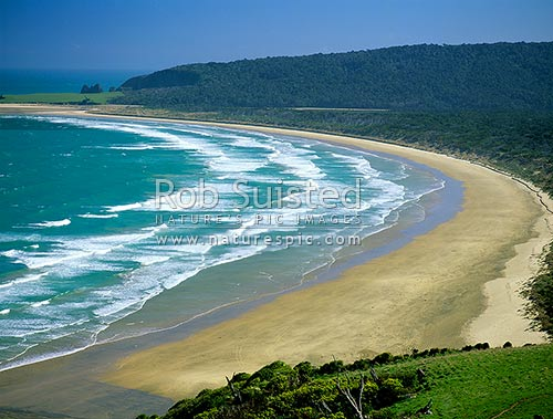 Wide sandy Tautuku Beach below Florence Hill, on the Catlins coastline, Catlins, Clutha District, Otago Region, New Zealand (NZ) stock photo.