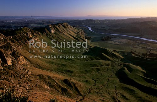 Sunrise on Te Mata Peak (399m). Overlooking Hawke's Bay and the Tukituki River, Hawke's Bay, Hastings District, Hawke's Bay Region, New Zealand (NZ) stock photo.