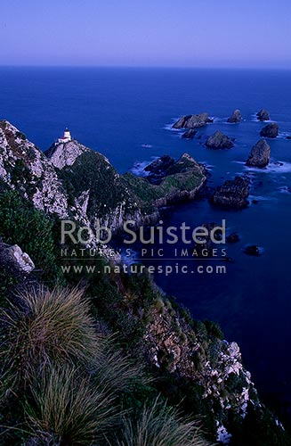 Nuggets Lighthouse after dark. Nugget point, Catlins. South Otago, Catlins, Clutha District, Otago Region, New Zealand (NZ) stock photo.