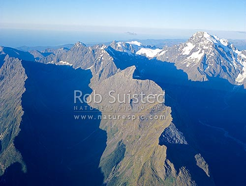 Mount Tutuko, Fiordland's highest, (2746m-right), and Bowen (left) and Tutuko Valleys (right), Milford Sound, Fiordland National Park, Southland District, Southland Region, New Zealand (NZ) stock photo.