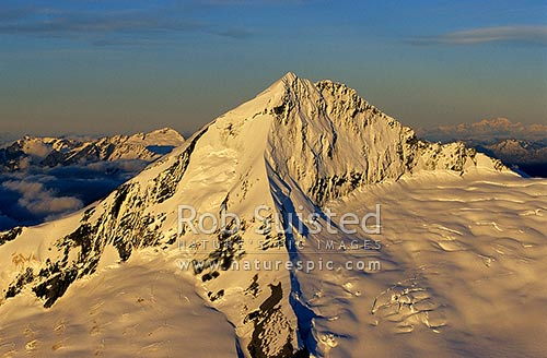 Aerial view of Mount (Mt) Aspiring (3033m) from the south west; Bonar Glacier in foreground; SW Ridge centre, Mount Aspiring National Park, Queenstown Lakes District, Otago Region, New Zealand (NZ) stock photo.