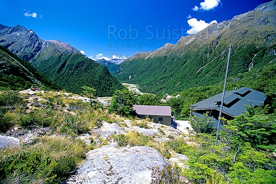 Routeburn Falls Hut, high above the Routeburn Valley; Routeburn Great Walk track. Hiking the Routeburn Track, Mount Aspiring National Park, Queenstown Lakes District, Otago Region, New Zealand (NZ) stock photo.
