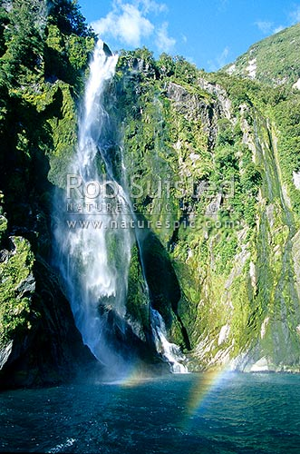 Stirling Falls (146m) spilling from a glaciated hanging valley into Milford Sound, Fiordland National Park, Southland District, Southland Region, New Zealand (NZ) stock photo.