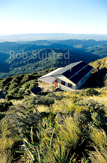 New Powell Hut overlooking the Wairarapa from Mount (Mt) Holdsworth. Mt Holdsworth-Jumbo Track, Tararua Forest Park, Masterton District, Wellington Region, New Zealand (NZ) stock photo.