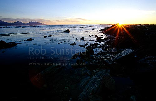 Seaward Kaikoura Mountains from Point Kean platform; sunrise, Kaikoura, Kaikoura District, Canterbury Region, New Zealand (NZ) stock photo.
