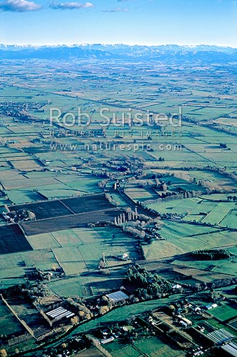Early morning aerial view over the Canterbury Plains; Southern Alps beyond, Christchurch, Selwyn District, Canterbury Region, New Zealand (NZ) stock photo.
