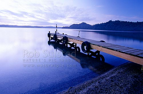 Twilight over Lake Rotoma and jetty, Rotorua lakes, Rotorua District, Bay of Plenty Region, New Zealand (NZ) stock photo.