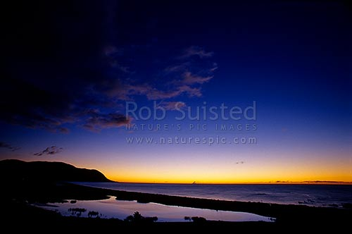 Sunset over Papatea Bay and the Bay of Plenty. Brilliant colours, East Cape, Opotiki District, Bay of Plenty Region, New Zealand (NZ) stock photo.