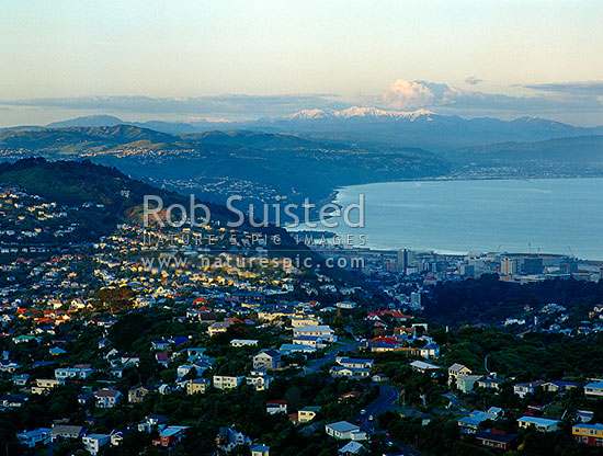 Overlooking Wellington and harbour, towards the snow covered Tararua Ranges beyond the Hutt Valley, Wellington, Wellington City District, Wellington Region, New Zealand (NZ) stock photo.