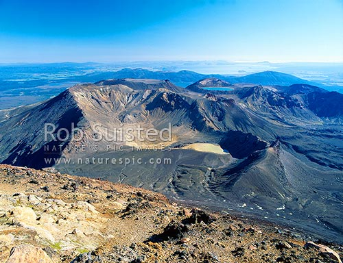 Looking over South Crater, Red Crater & Blue Lake of Mount Tongariro, to Lake Taupo from Mt Ngauruhoe. Tongariro Crossing Great Walk, Tongariro National Park, Taupo District, Waikato Region, New Zealand (NZ) stock photo.