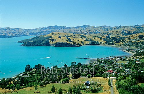 Akaroa township in French Bay of Akaroa Harbour, Banks Peninsula, Christchurch City District, Canterbury Region, New Zealand (NZ) stock photo.