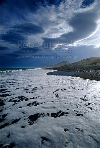 Dramatic cloud formations over a secluded beach on the Kaikoura Coast, Kaikoura, Kaikoura District, Canterbury Region, New Zealand (NZ).