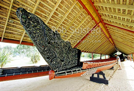 Whare Waka (Canoe house) with 35 metre Waka (war canoe - right) - Waitangi National Reserve, Bay of Islands, Far North District, Northland Region, New Zealand (NZ) stock photo.