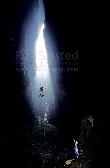 New Zealand Location >> A tour group descending into the misty 'Lost World' cave - 100m abseil and cave tour, Waitomo ...