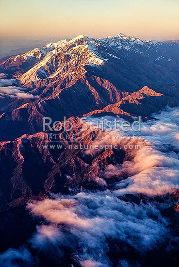 Seaward Kaikoura Range at dawn from the north. Clarence Valley in cloud, Marlborough, Marlborough District, Marlborough Region, New Zealand (NZ) stock photo.