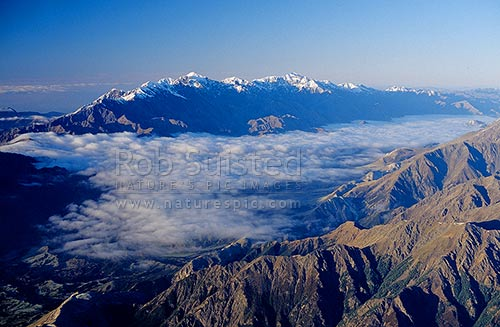 Seaward Kaikoura Range. Clarence Valley in cloud, Inland Kaikoura Range in foreground, Marlborough, Marlborough District, Marlborough Region, New Zealand (NZ) stock photo.