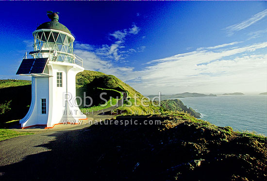 Cape Reinga lighthouse with Cape Maria van Dieman beyond, Far north, Northland, Far North District, Northland Region, New Zealand (NZ) stock photo.
