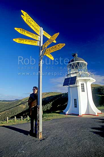 Cape Reinga lighthouse and signpost, Far north, Northland, Far North District, Northland Region, New Zealand (NZ) stock photo.