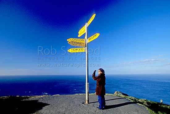 Sign post at Cape Reinga lighthouse, Far north, Northland, Far North District, Northland Region, New Zealand (NZ) stock photo.
