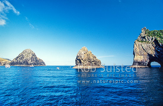 Hole in the Rock - Piercy Island (Right) and Cape Brett (Left), Bay of Islands, Far North District, Northland Region, New Zealand (NZ) stock photo.
