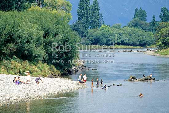 People enjoying summer in the Takaka River, Takaka, Tasman District, Tasman Region, New Zealand (NZ).