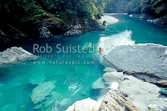 Kayaking in Tomtit Grotto. Haast River. Large rocks, South Westland, Westland District, West Coast Region, New Zealand (NZ) stock photo.