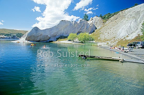 Summer swimming in Blue Lake. Lake formed from old gold sluicing operations late 1800, St Bathans, Central Otago District, Otago Region, New Zealand (NZ) stock photo.