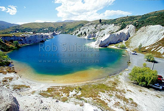 Blue Lake, St Bathans. Lake formed from old gold sluicing operations late 1800, St Bathans, Central Otago District, Otago Region, New Zealand (NZ) stock photo.