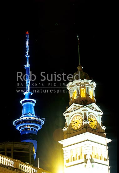 The Auckland Sky Tower above the old Auckland Town Hall Clock tower, at night, Auckland, Auckland City District, Auckland Region, New Zealand (NZ) stock photo.