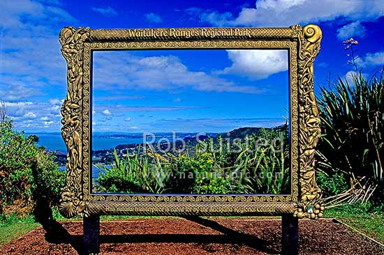 Interpretation panel framing the lookout over the Waitakere Ranges ...