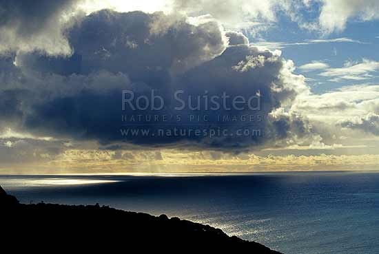 Heavy cloud over the sea, Piha Beach, Waitakere City District, Auckland Region, New Zealand (NZ) stock photo.