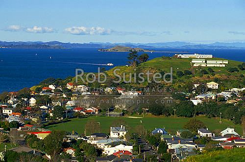 Looking across Devonport to the Hauraki Gulf. Browns Island (Motukorea) centre, Motuihe left. North Head right, Auckland, Auckland City District, Auckland Region, New Zealand (NZ) stock photo.