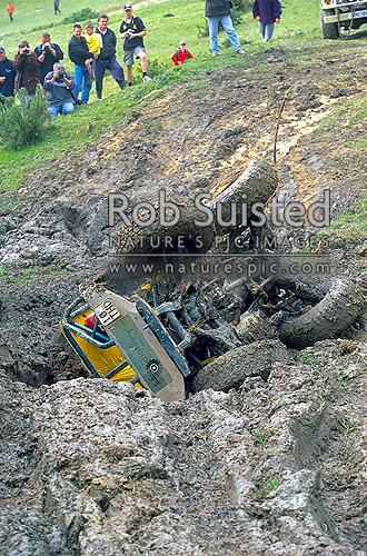 Four wheel drive enthusiasts competing in event (4x4). Rolling over, Porirua, New Zealand (NZ) stock photo.