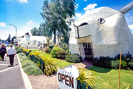 Tourist shops at Tirau depicting giant Sheep (right) and sheep dog (left), Tirau, South Waikato District, Waikato Region, New Zealand (NZ) stock photo.