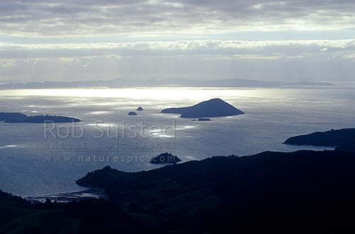 Motuoruhi Island in the Hauraki Gulf, from the Coromandel Ranges. Auckland beyond, Coromandel, Thames-Coromandel District, Waikato Region, New Zealand (NZ) stock photo.