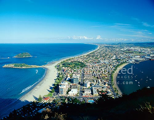View from Mount (Mt) Maunganui (232m) over beach and Moturiki and Motuotau Islands, Mt Maunganui, Tauranga District, Bay of Plenty Region, New Zealand (NZ) stock photo.