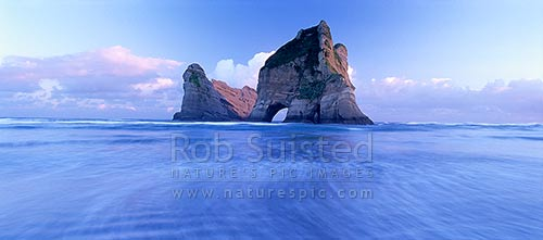The Archway Islands on Wharariki Beach; Puponga Farm Park, near Farewell Spit, Farewell Spit, Golden Bay, Tasman District, Tasman Region, New Zealand (NZ) stock photo.