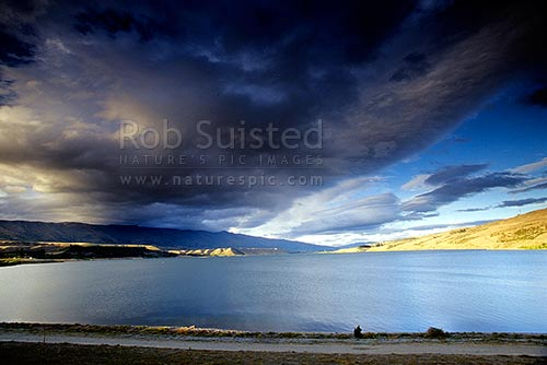 Storm clouds brewing over Lake Dunstan, Cromwell, Central Otago District, Otago Region, New Zealand (NZ) stock photo.