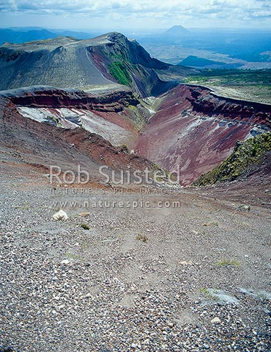 Mount (Mt) Tarawera (1111m) which violently erupted (1886) with large loss of life and destruction of the Pink and White Terraces. Mount (Mt) Edgecumbe beyond, Rotorua, Rotorua District, Bay of Plenty Region, New Zealand (NZ) stock photo.