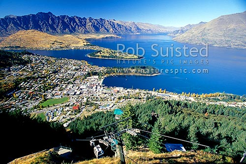 The Remarkables Mountains, Lake Wakatipu and Queenstown from the Skyline Gondola, Queenstown, Queenstown Lakes District, Otago Region, New Zealand (NZ) stock photo.