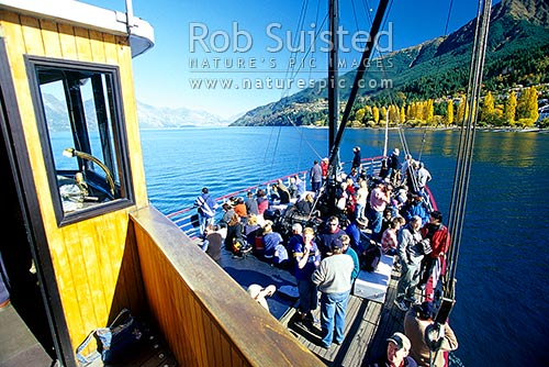 TSS Earnslaw - historic steamship on Lake Wakatipu, leaving at Queenstown for Walter Peak Station since 1912, Queenstown, Queenstown Lakes District, Otago Region, New Zealand (NZ) stock photo.