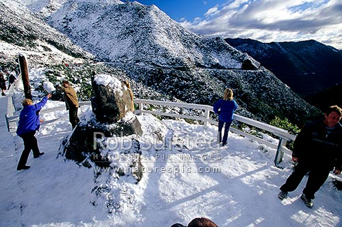 People enjoying the winter snow at the summit of the Remutaka (Rimutaka) Hill Road (555masl, State Highway 2), Remutaka, Upper Hutt City District, Wellington Region, New Zealand (NZ) stock photo.