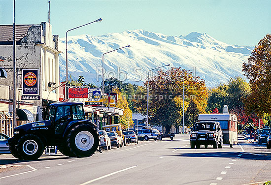 Main street of Fairlie, with the Two Thumb Range behind. Tractors and caravans. South Canterbury, Fairlie, MacKenzie District, Canterbury Region, New Zealand (NZ) stock photo.