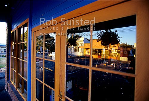 Reflection of the main road of Carterton in shop window, Carterton, Carterton District, Wellington Region, New Zealand (NZ) stock photo.