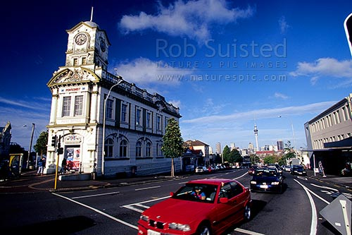 Ponsonby Post Office and Sky Tower with traffic. 1990's, Auckland, Auckland City District, Auckland Region, New Zealand (NZ) stock photo.