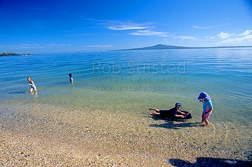 Rangitoto island behind children swimming and playing in - Mission bay swimming pool auckland ...