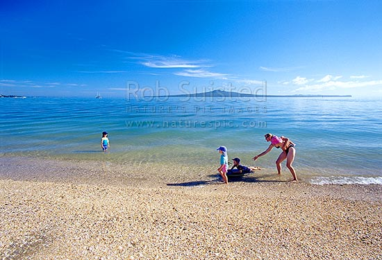 Rangitoto Island Behind Children Swimming At Mission Bay Beach Auckland City District Region New Zealand Nz Stock Photo