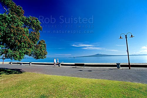 Rangitoto Island viewed from Mission Bay Beach, Mission Bay, Auckland City District, Auckland Region, New Zealand (NZ) stock photo.