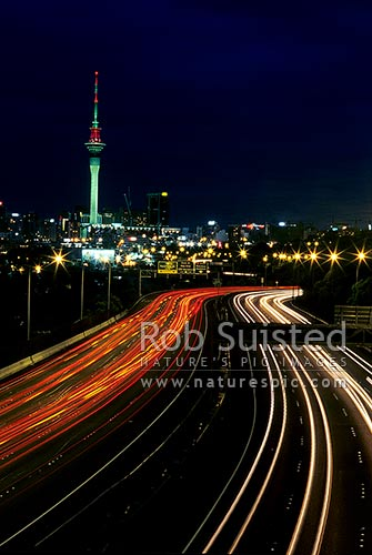 Auckland City Skyline, Sky Tower and motorways at night with city and car lights streaked, Auckland, Auckland City District, Auckland Region, New Zealand (NZ) stock photo.